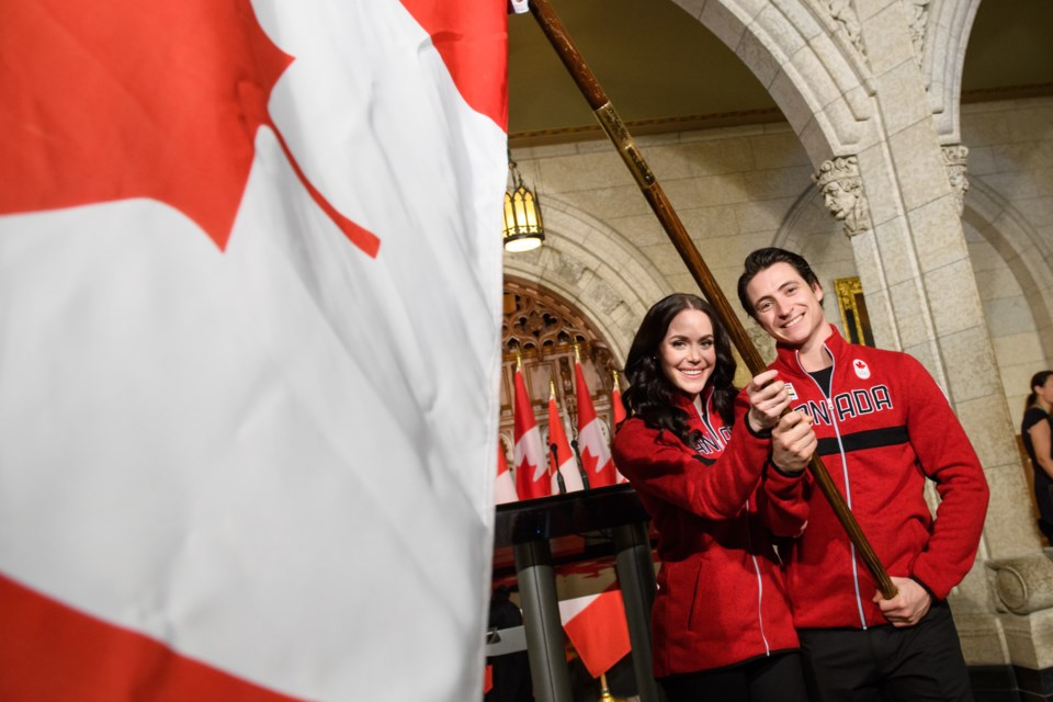 Figure skaters Tessa Virtue and Scott Moir were announced as Canada's flag bearers for the opening c