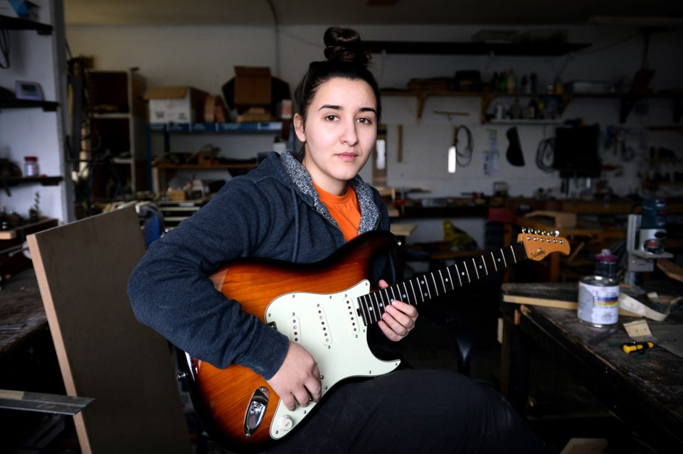 Vancouver luthier Meredith Coloma is considering moving her business to Surrey or Maple Ridge in lig