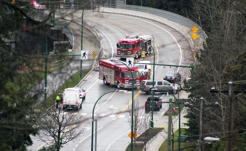 Emergency crews attend the site of a fatal crash on Cariboo Road in January that saw a 15-year-old girl killed on a controversial crosswalk.