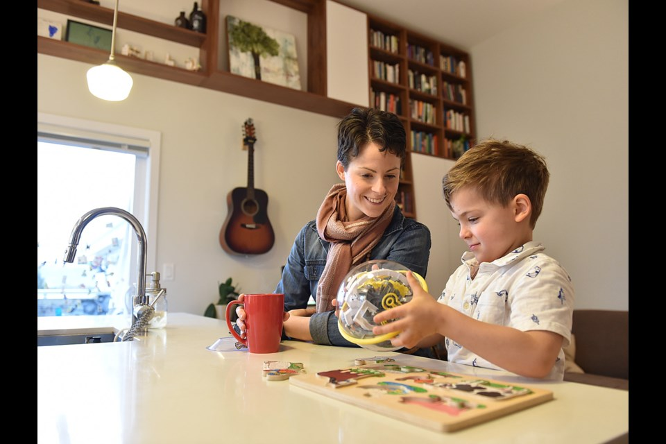 Ericka Stephens-Rennie and her son Jacob, four, spend time together in their unit in the Vancouver Cohousing complex in East Van. Photo Dan Toulgoet