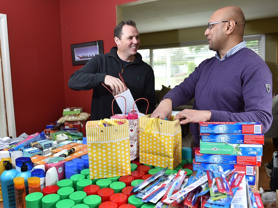 Paul Williams, a pastor at Granville Chapel, and Nizar Assanie are among Marpole residents who colle