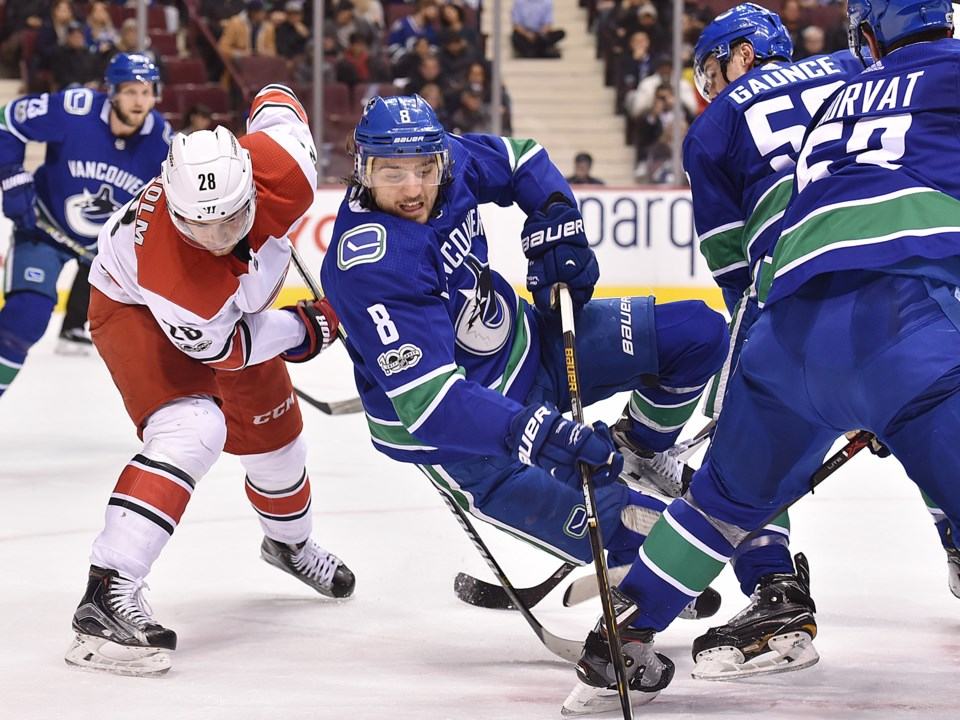 Chris Tanev falls to the ice.