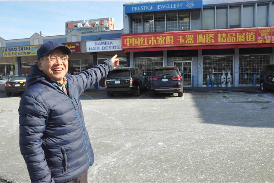 Richmond resident Fanrong Kong was walking by this ceramics shop on No. 3 Road when the Richmond News was conducting a street poll on Chinese-only signage. Kong said a bylaw should be in place to ensure English is a common language on business signs. Photo by Daisy Xiong Feb. 20, 2018.