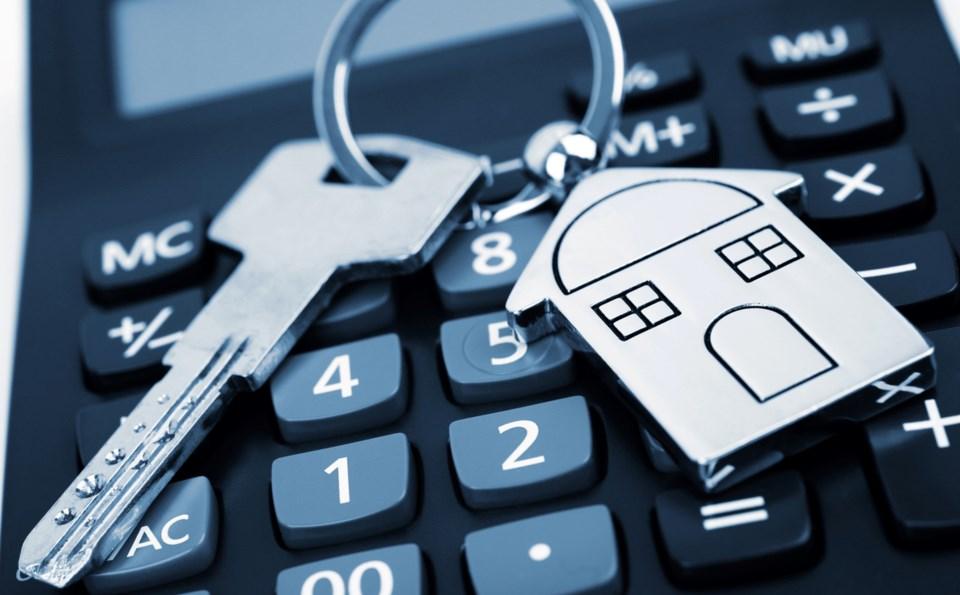 Calculator keys house tax money finances