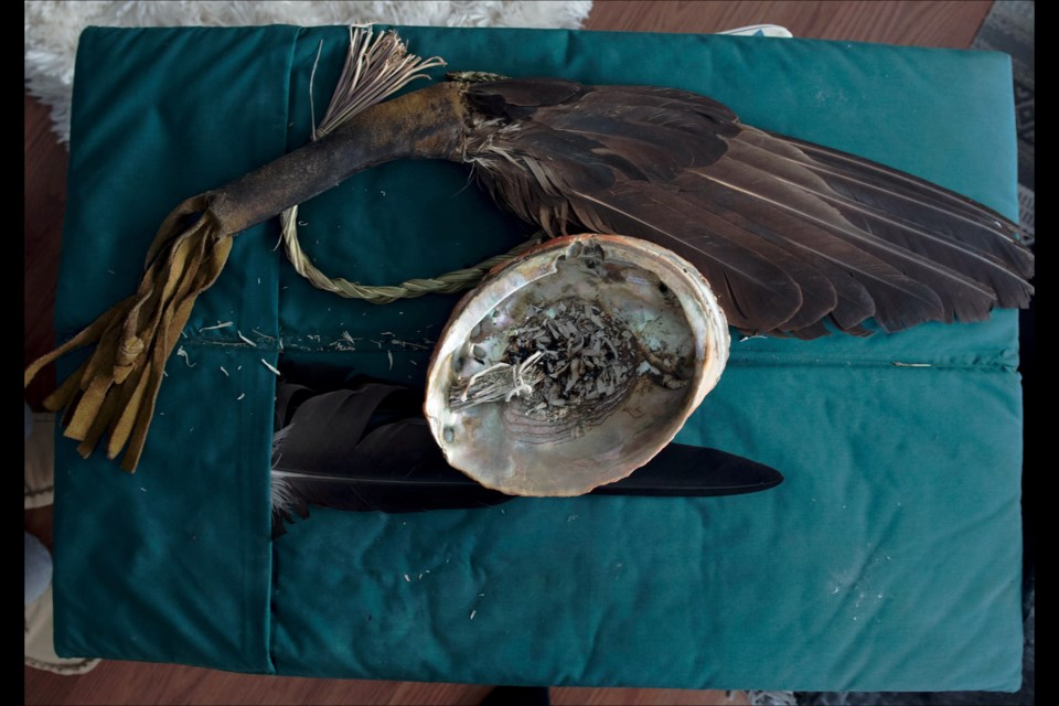 An eagle fan, smudge bowl, sweet grass and sage. These items are for ceremonial use and are an integral part of traditional medicine, spirituality and healing. Reprinted from The Lancet, https://doi.org/10.1016/S0140-6736(18)30468-9, Palmer, Picturing health: health advocates for Indigenous communities in British Columbia, Canada, Copyright (2018), with permission from Elsevier