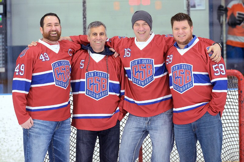 From left, team members Tom Levesque, Ken Carrusca, Jason Howell and Wes Reamsbottom reunite at 8 Rinks in Burnaby. In January, Carrusca's life was saved by an AED after a cardiac arrest during a hockey game at the rink.