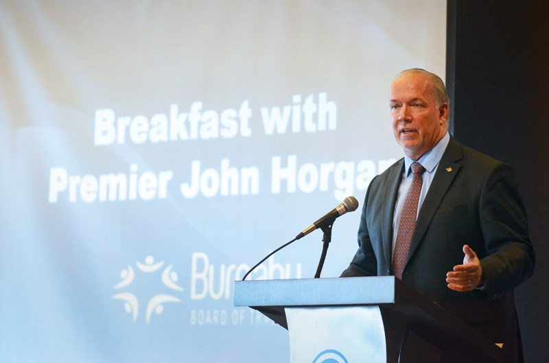 B.C. Premier John Horgan speaks at a Burnaby Board of Trade breakfast event Wednesday.