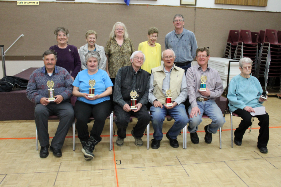The Mile Zero Cribbage tournament. Front row: First prize winner Joe Marion; Betty Gawley, Dave Russell, and Jim Kobasiuk, tied for second; third place winner Glen Babcock; and Eunice Minchau. Back row: Directors Lillian Kuros, Mary Kidd, Sharon Murray, Joy Nobbs, and sponsor Gary Chard of GCM Laundry.