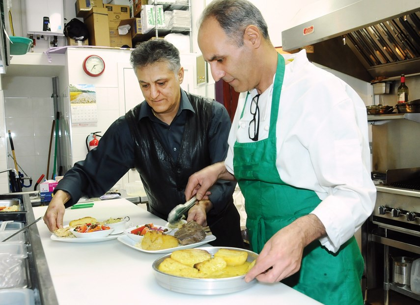 Chef/owner Mike Sarbakhteh and sous chef Cyrus Pakzad prepare traditional Greek dishes in the kitchen at Kostas Mediterranean at 751 Lonsdale Ave., North Vancouver.