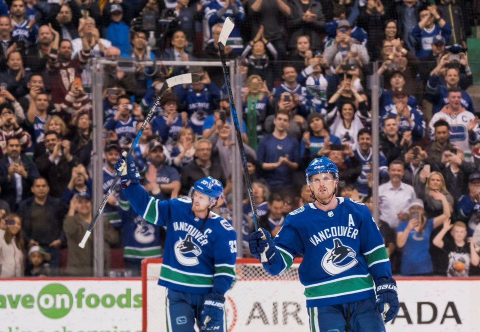Daniel and Henrik Sedin salute the crowd at their final home game.