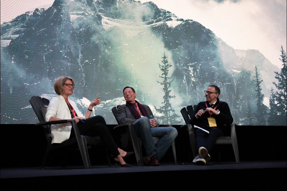"""MP Pamela Goldsmith-Jones interviews Vancouver real estate marketer Bob Rennie and JJ Bean Coffee founder John Neate during a """"fireside chat."""""""