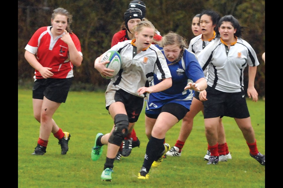 Kseniya Yakovenko of the Carson Graham senior girls rugby team charges up the field during an exhibition match against Richmond's R.A. McMath Secondary played April 5 at the Lucas Centre field. High school girls rugby is taking off on the North Shore. photo Paul McGrath, North Shore News