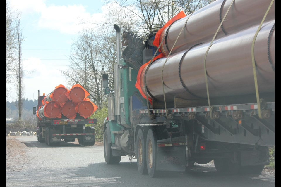Truckloads of pipes arrive at Kinder Morgan's staging facility in New Westminster on April 12. Additional pipe shipments were spotted Monday.