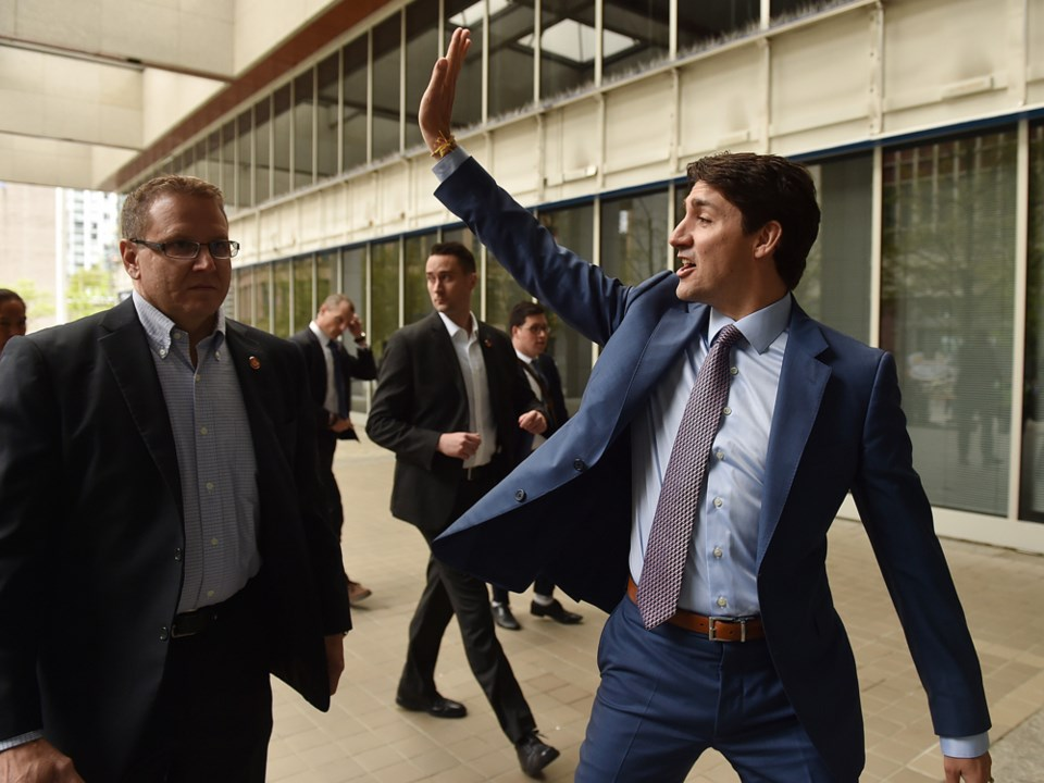 Justin Trudeau waves to protesters in Vancouver