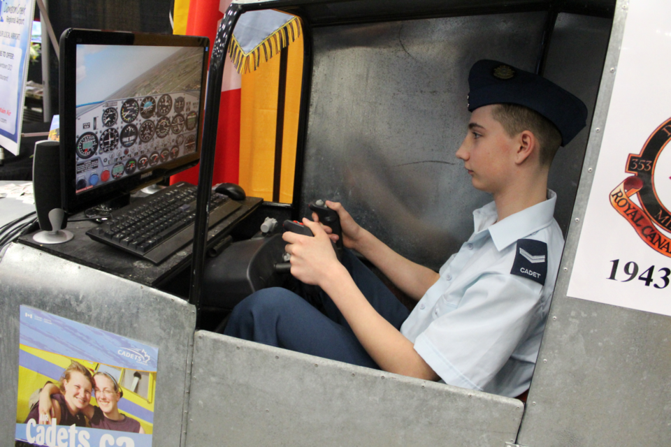 Corporal Cole Jensen of the air cadets gives the flight simulator a go.