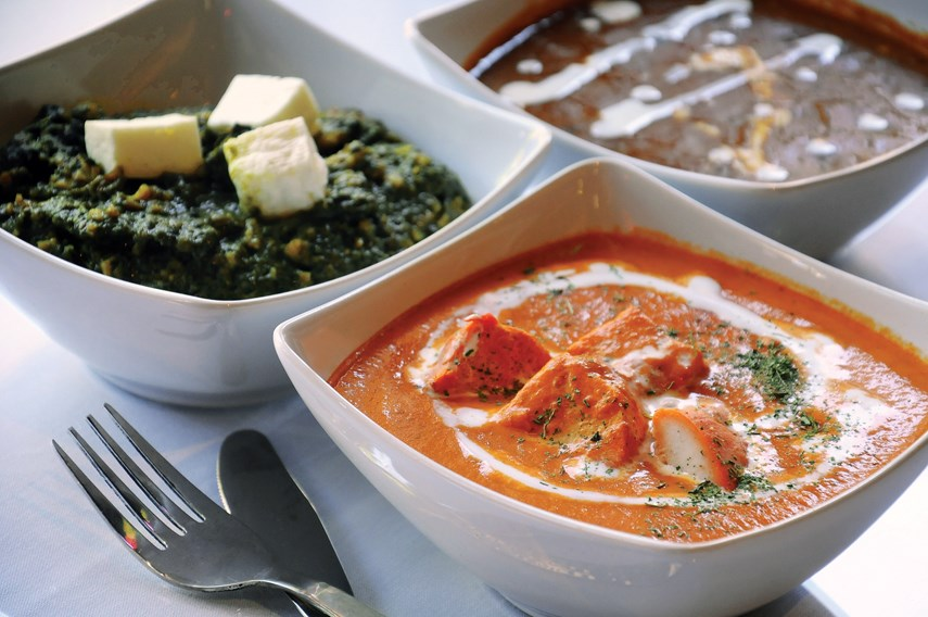 Delhi Belly dishes include Butter Chicken, Palak Paneer, Daal, Garlic Naan and Basmati Rice.