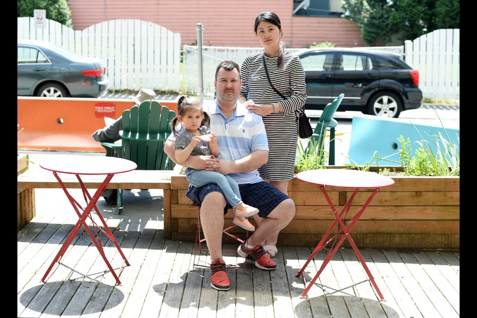 utt out: Adrian Beer, with his daughter Sophia and wife Lynn, wants the city to do more to stop smoking at the Belmont Street parklet.