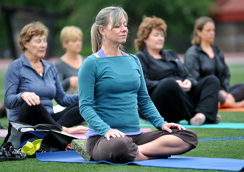 MARIO BARTEL/THE TRI-CITY NEWSYoga enthusiasts in the Tri-Cities were able to take their oms outside Thursday at a special open yoga session held at Percy Perry Stadium in Coquitlam to celebrate International Yoga Day. The worldwide observation of yoga day began in 2015 after Indian prime minister Narendra Modi proposed it during an address to the General Assembly of the United Nations the year before. The theme for this year's event was peace.
