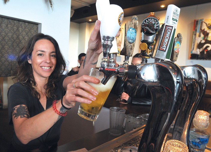 Manager Samantha Carins pours a pint at Finch & Barley.