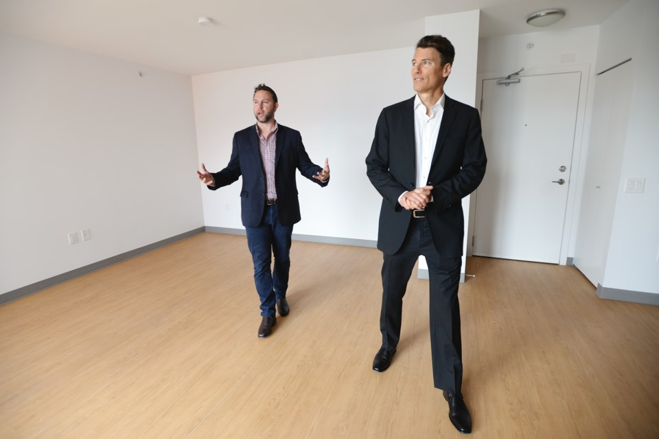 Mayor Gregor Robertson (right) checks out one of the units in Belcourt Residence. Photo Jennifer Gau