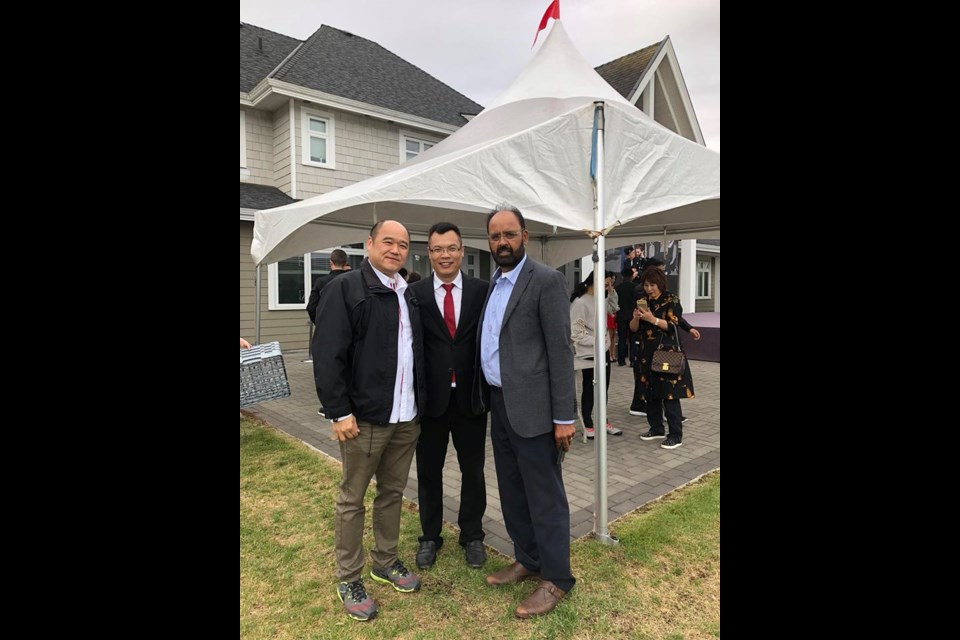 """Peter Liu (middle) seen in a photo posted to Facebook labelled as """"Farmland Owners Association BBQ"""" with Richmond realtors Chris Chan (left) and Gurdial Dale Badh (right). While some questioned Liu's possible presence at the BBQ, Coun. Bill McNulty said Liu was at another event at the same site. Photo: Chris Chan/Facebook"""