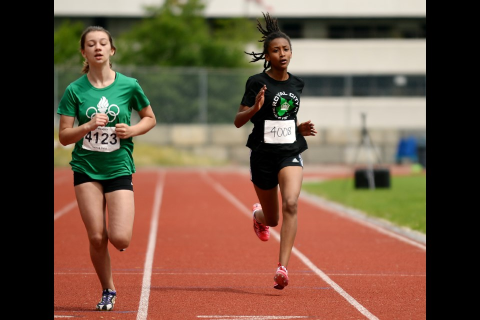 Closing in on the finish line is Lishan Melles-Hewitt, at right, of the Royal City Track and Field Club. The Div. 12 girls competitor placed second in the 1200-metre race.