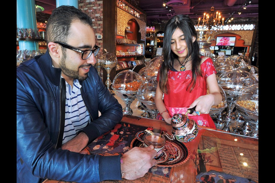 Maral Shahpour pours saffron tea for her father Ali at the Saffron Palace. The West Vancouver shop sells Middle Eastern nuts, dried fruit, tea and spices.