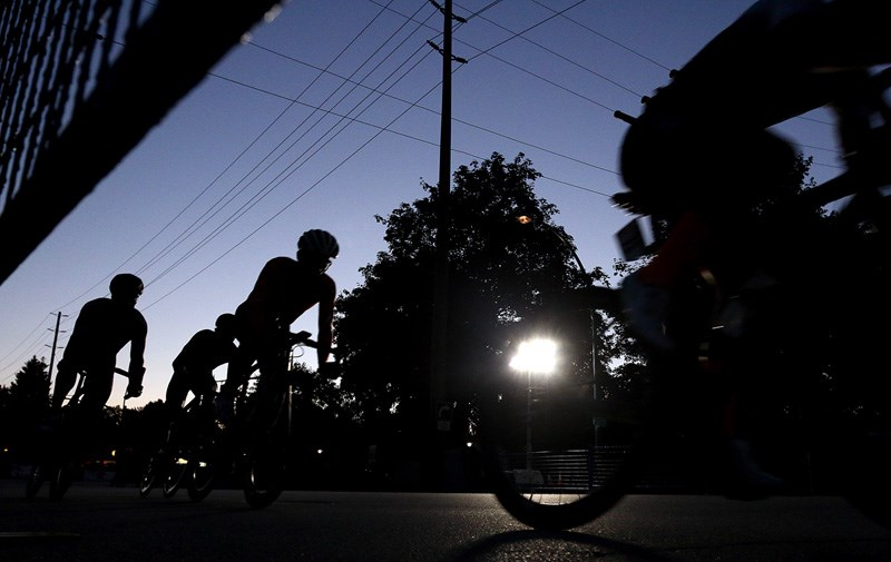 MARIO BARTEL/THE TRI-CITY NEWSThe early laps of the pro men's race at the PoCo Grand Prix are held in dwindling twilight.