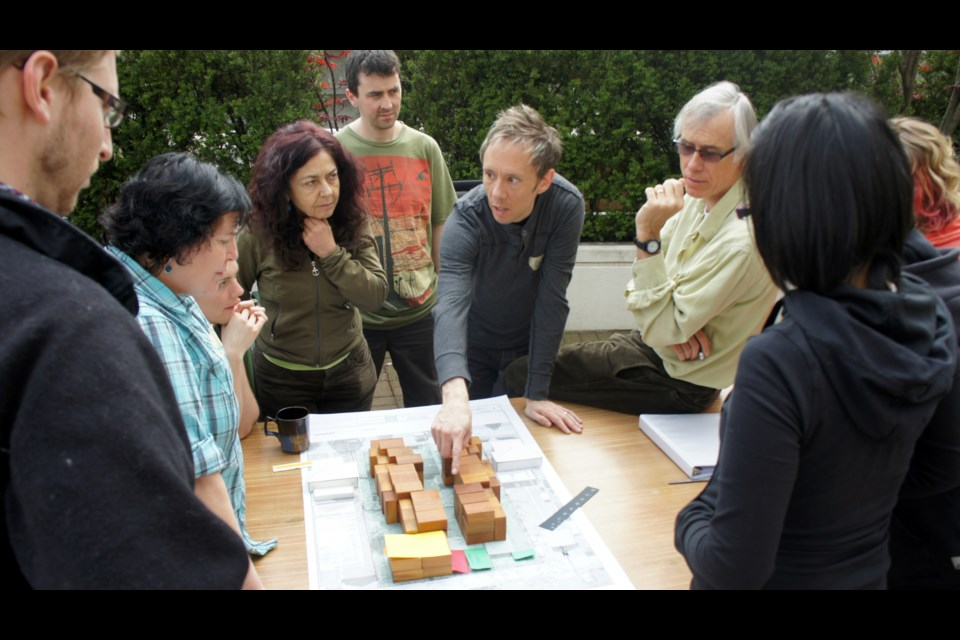 Charles Durrett ( on the right side wearing glasses) helped design the city's first cohousing project — Vancouver Cohousing in East Vancouver.