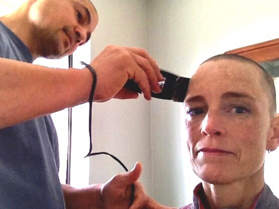 Mary's head being shaved in anticipation of the harsh effects of chemotherapy