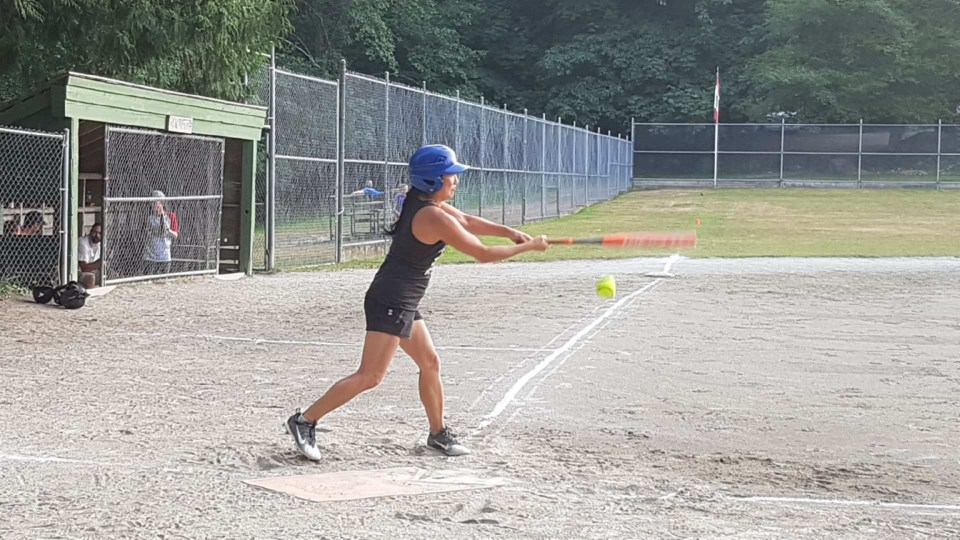 Logger teammate Nancy Lee swings for a ball Tuesday night.