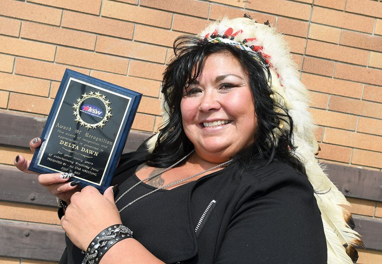 Prince George's Dawn Murphy shows an award she received from All Star Wrestling. – Citizen photo by Brent Braaten