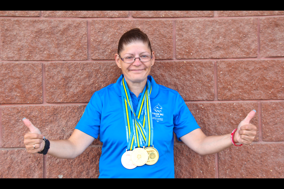 Sheryl Jakubowski proudly shows off the three medals she won at the 2018 Special Olympics Canada Summer Games, on August 6.