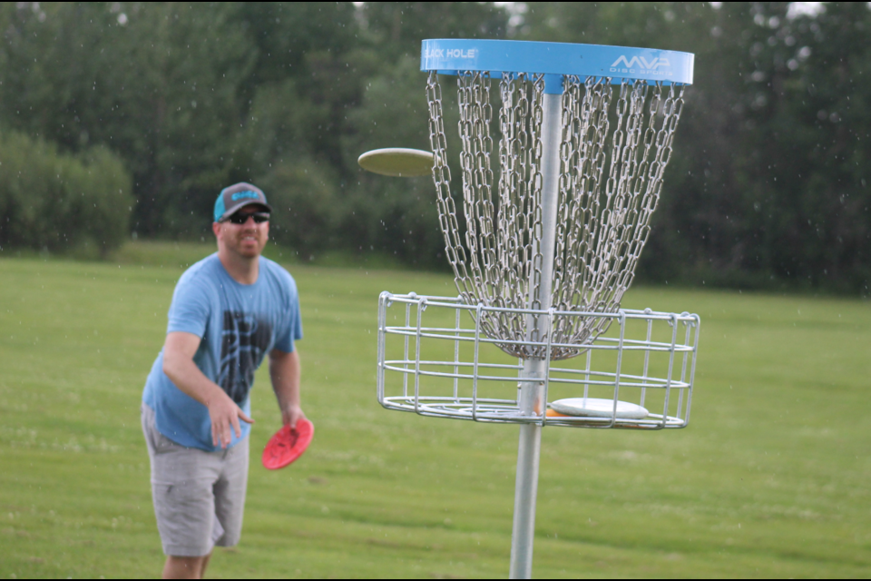 Clint Warkentin sinks a putt at the first ever Professional Disc Golf Association tournament in Northern BC.