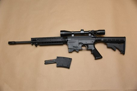 A Bushmaster 5.56 semi automatic seized during the investigation.