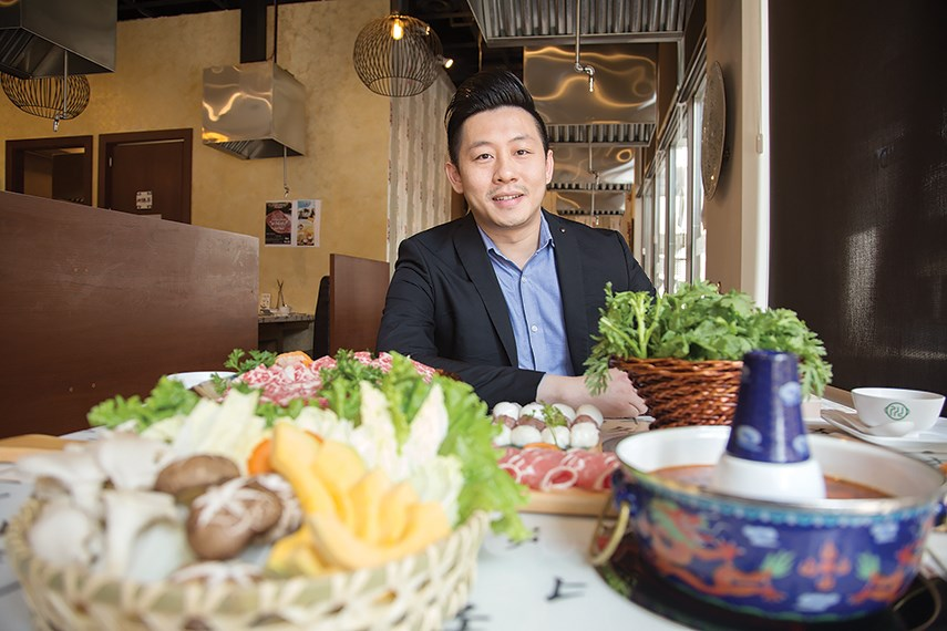Legendary Hot Pot manager Nick Ma with some of the dishes available at the Park Royal restaurant.
