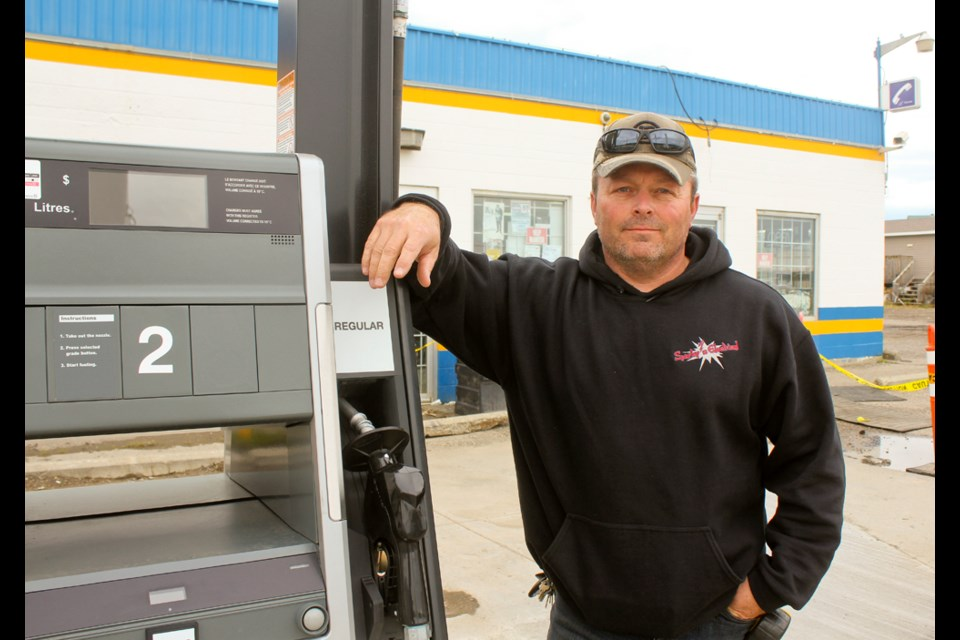 Charlie Lake Store owner Jack Hynes at one of the stations new fuel pumps. Hynes is working on major renovations to the store, with plans to reopen in November.