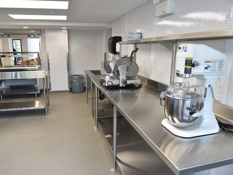 The M. Mitchell Place modular housing complex includes a commercial kitchen. Photo Dan Toulgoet