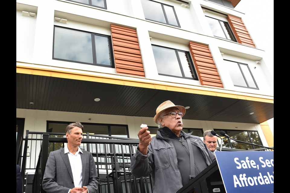 Musqueam elder Shane Pointe chanted in his language to welcome and bless the new modular housing complex opening at 2132 Ash St. Photo Dan Toulgoet