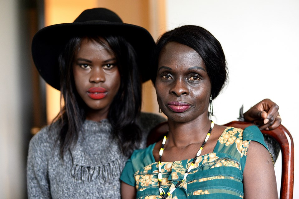 Adhel Arop, left, and her mother Amel Madut in the family's Burnaby apartment. Adhel has earned a $50,000 STORYHIVE grant to make a documentary about the story of her mother - a former fighter in the Sudanese People's Liberation Army - and how it shaped Adhel's own identity.