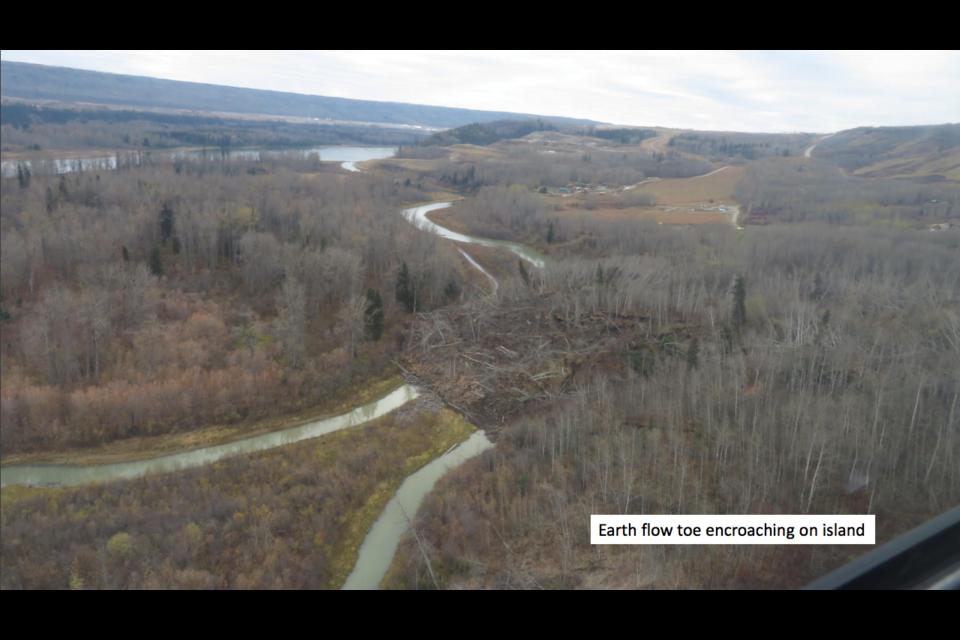 Old Fort landslide, earth flow toe encroaching on island.
