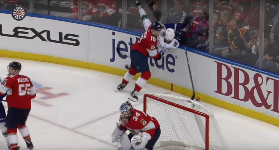 Michael Matheson slams Elias Pettersson to the ice in a game between the Panthers and Canucks.