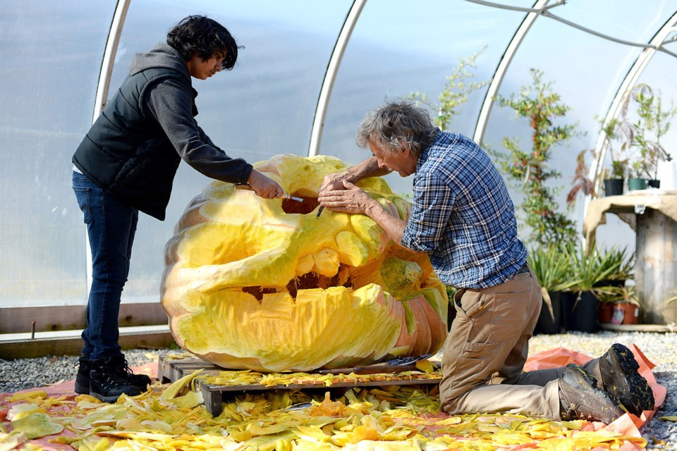 The Harvest Day Party at It's About Thyme Nursery featured pumpkin carving by George Rammell, with some help from Azaan Dossa.