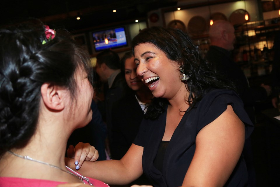 Newly elected trustee Gurveen Dhaliwal celebrates her win Saturday night.