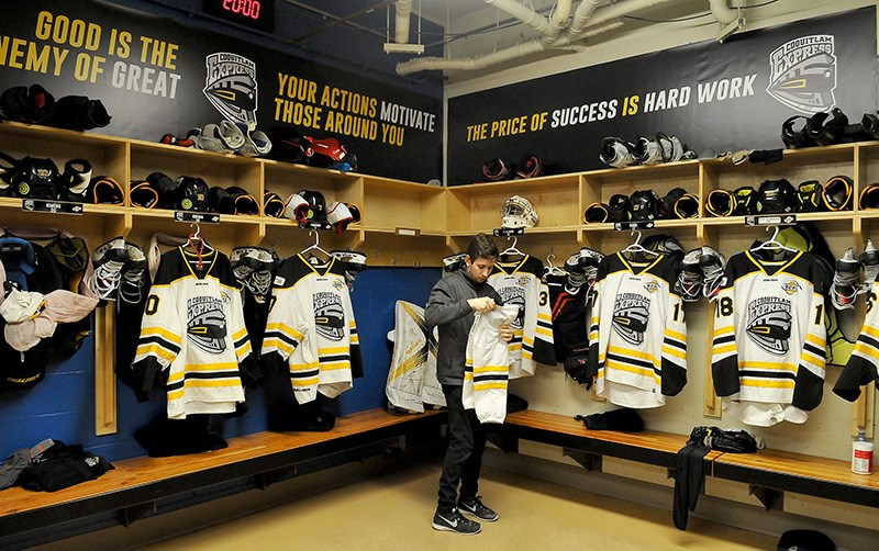 MARIO BARTEL/THE TRI-CITY NEWSCoquitlam Express trainer Ross Maceluch lays out uniforms and equipment for the players before their arrival for Wednesday's midday game against the Langley Rivermen.