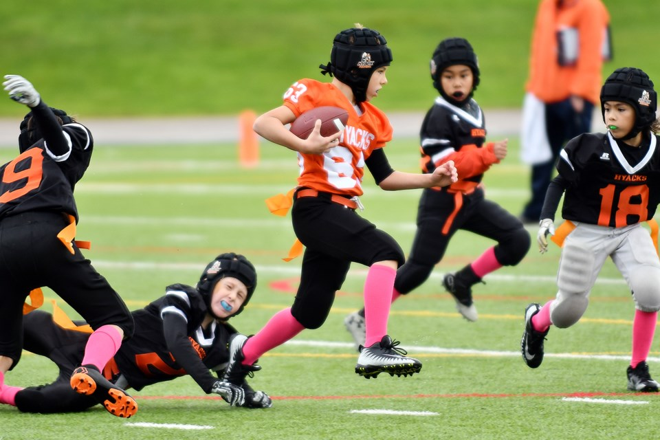 A brisk autumn day in New West became a cool day for football, as players for the Royal City Hyacks' flag football teams Orange and Black took to Mercer Stadium for a game last Saturday.