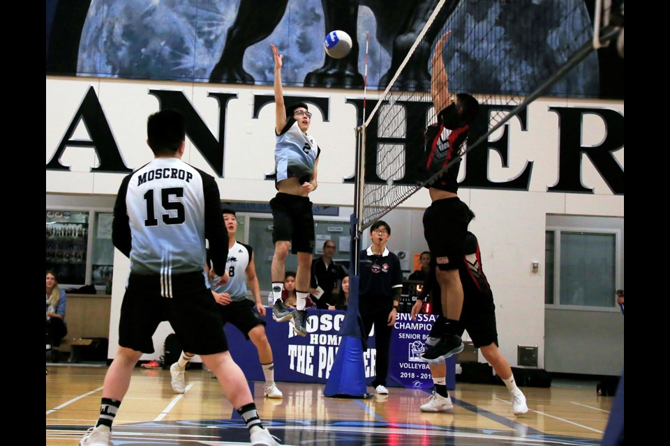 Moscrop's William Khor goes vertical to power a shot into the Burnaby Central court during Wednesday's league playoff final.
