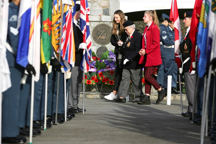 Photograph by Kevin Hill Susan Simpson of Royal Canadian Legion 148 lays a wreath in memory of her husband Brian, a Naval veteran, at the North Burnaby Remembrance Day ceremony in Confederation Park.