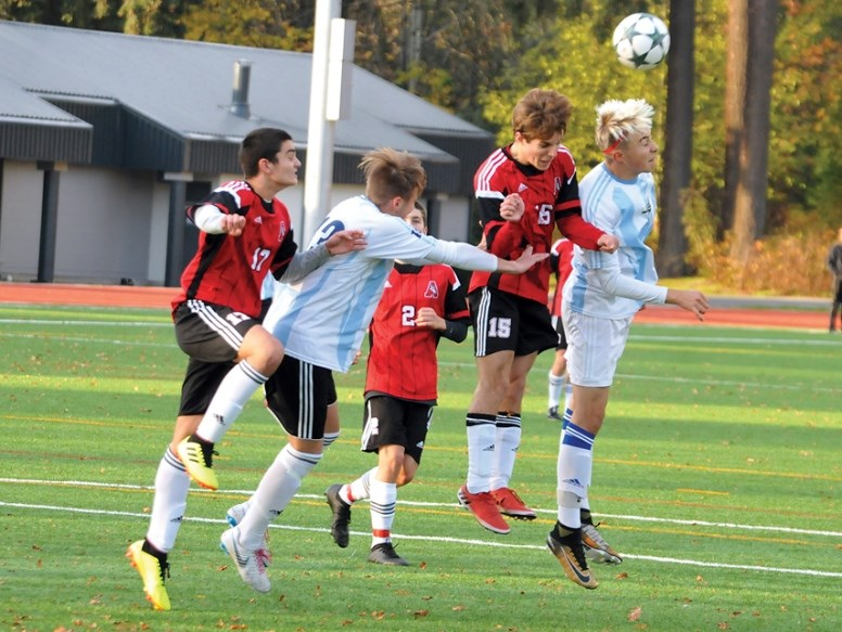 The Alpha Aztecs' Luca and Stefano Dal Sasso, in white, battle their St. Thomas Aquinas rivals for possession during last week's B.C. qualifier game.