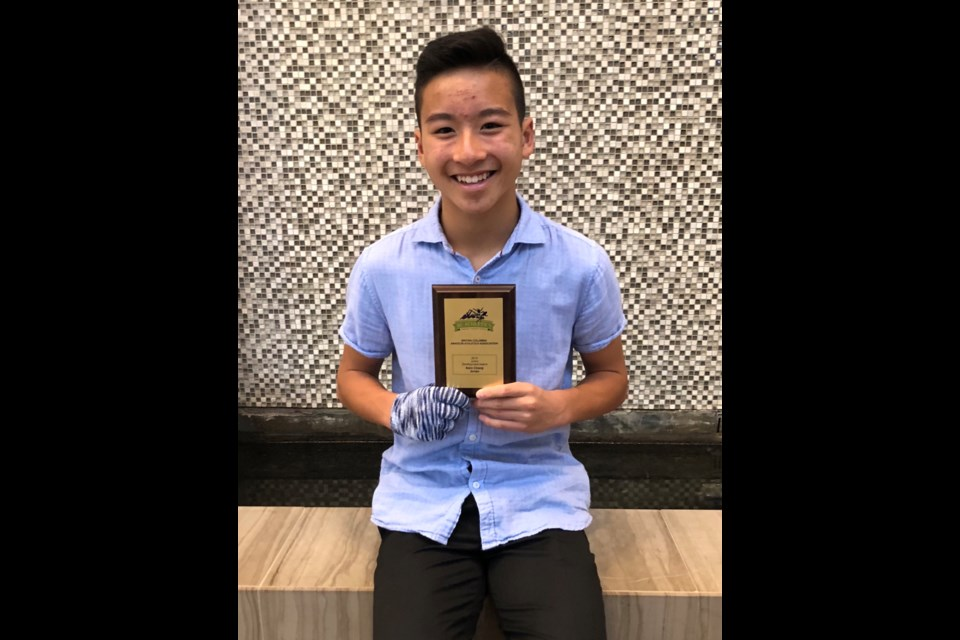 New Westminster's Kairo Chiang receive an award from B.C. Athletics last month in honour of his performance in both the pole vault and triple jump.